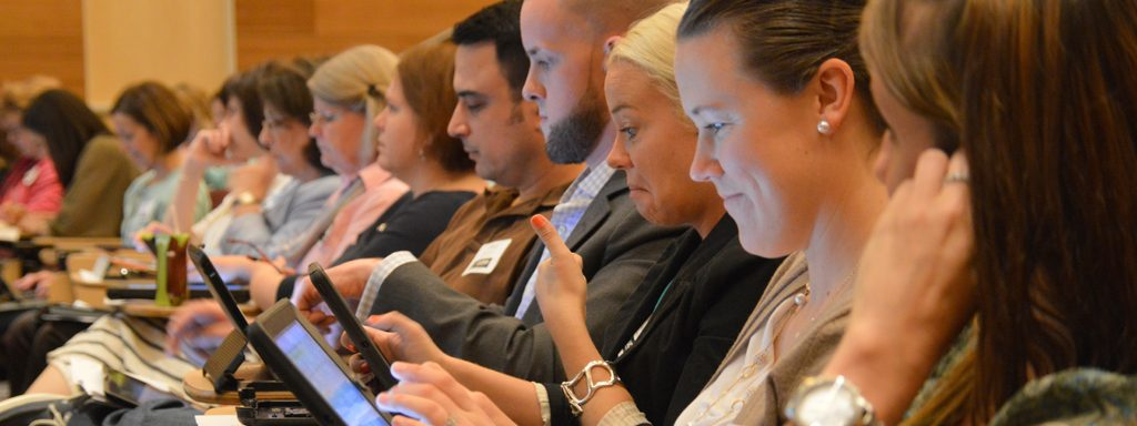 2014 attendees looking at tablets